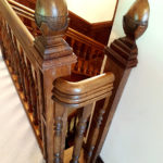 Oak handrail with carved acorn capping