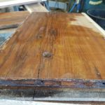 Applying a second coat of hardener to the end grain