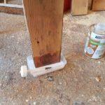 End grain of door stiles being socked up with wood hardener