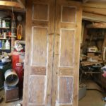 Doors ready for paint, notice panel edges are already protected.