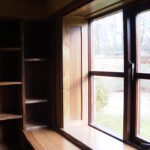 Waney edge library shelves and panelled window