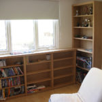 Low level bookcase leading into tall bookcase in oak
