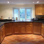 kitchen with arched doors in oak