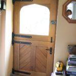 Stable door with cross panels looking from inside