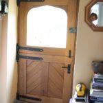 Stable door with cross panels looking from inside