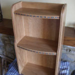 blue inlay in oak bookcase