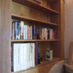 bookcase at end of stairs