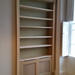 bookcase with hidden radiator
