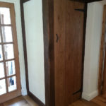 cupboard created in the style of the cottage with bulging walls and oak timber framing beams