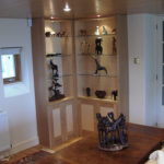 display units in oak and maple burr with glass shelves