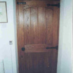 door in dark oak with arched top rail