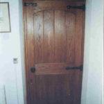 door in dark oak with arched top rail