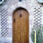 door in distressed oak with arch and ledges from the front