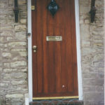 door in mahogany with diamond window