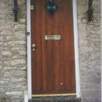door in mahogany with diamond window