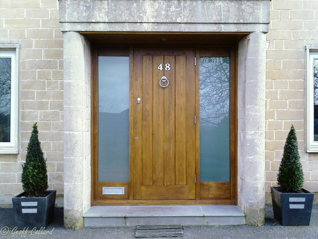 Solid oak door with satin glass side lights in Cleveland Walk Bath