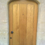 door in oak with arch in wellow bath
