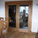 door in oak with full glass panels
