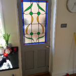 door painted idigbo with stain glass panel