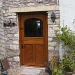 door stable door in oak with cross boarding and glazed top door
