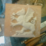 gryphon carved out of polyester resin which give crisp detail