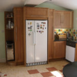 kitchen in oak with american fridge freezer