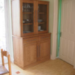 Freestanding kitchen cabinet in oak with glass doors
