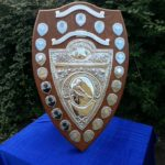 large mahogany shield with silver presentaion plaques