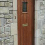 mahogany door with little arch window