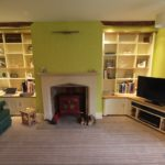 alcove cupboards with oak tops and tv shelf