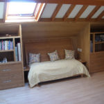 office bedroom with seating which pulls out from the eaves to form a bed