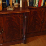 secret bookcase door showing fluted columns and mahogany curl veneer with inlay and crossbanding on doors