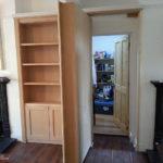 secret bookcase door in london with door open