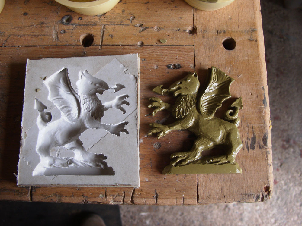 silicone mould and casting made from powdered brass and resin once buffed looks like solid polished brass