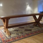 table in solid oak and cross legged design