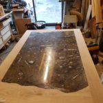 table with geology fossil slab for bath university
