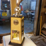 trophy in gloss black and birds eye maple