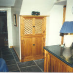 Pine units under stairs to match kitchen