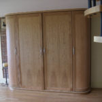 wardrobe with curved ends and in oak