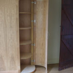 wardrobe with curved ends and in oak with end door open