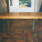 table with stainless steel legs & oak table extendable