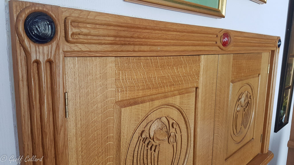 carved architrave with inset resin rose casts