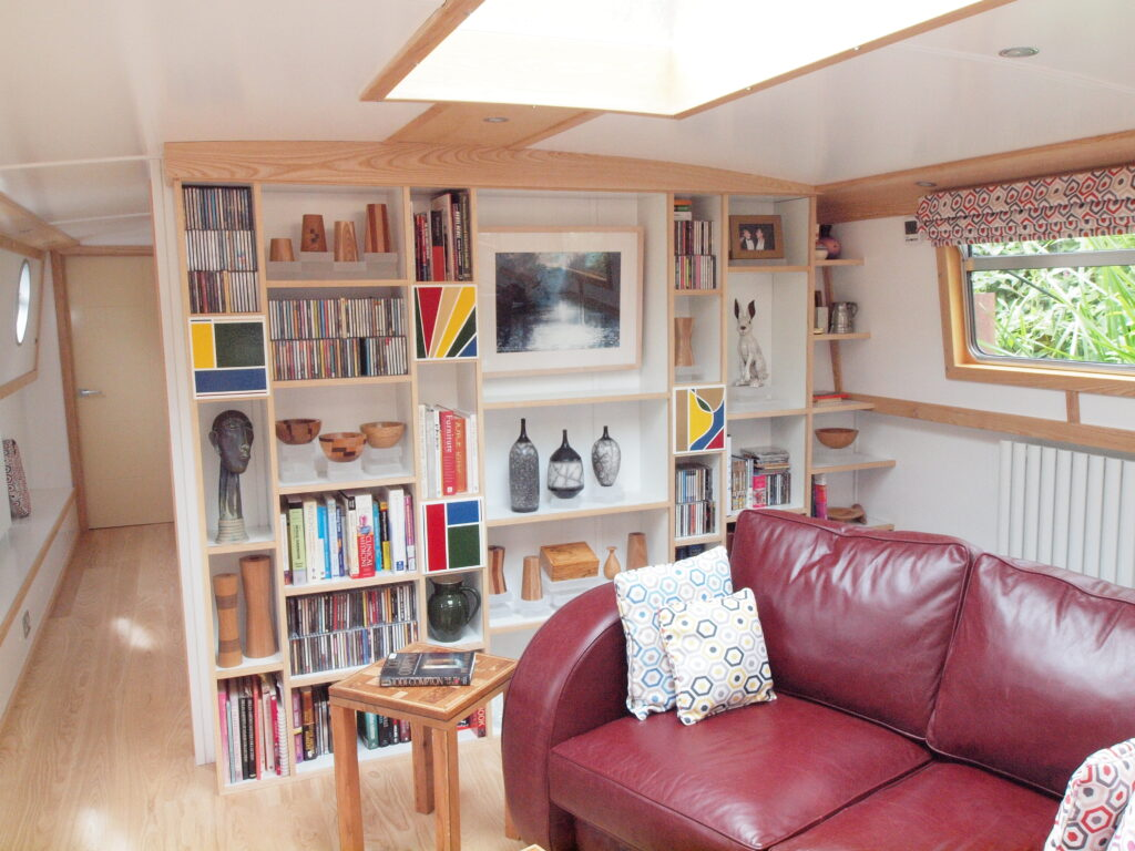 Wide beam canel boat with Ash and white melamine bookshelves