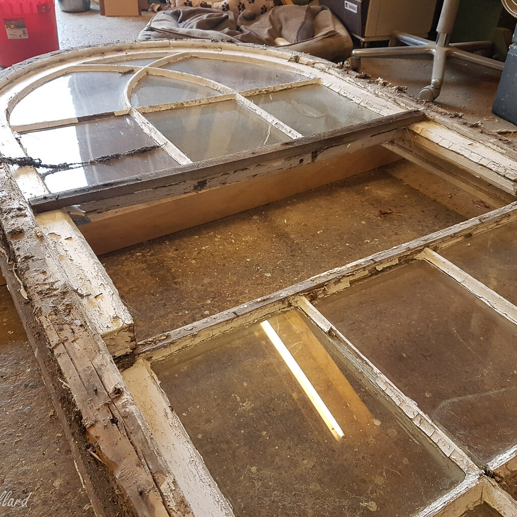 On the bench window to be restored now in the workshop