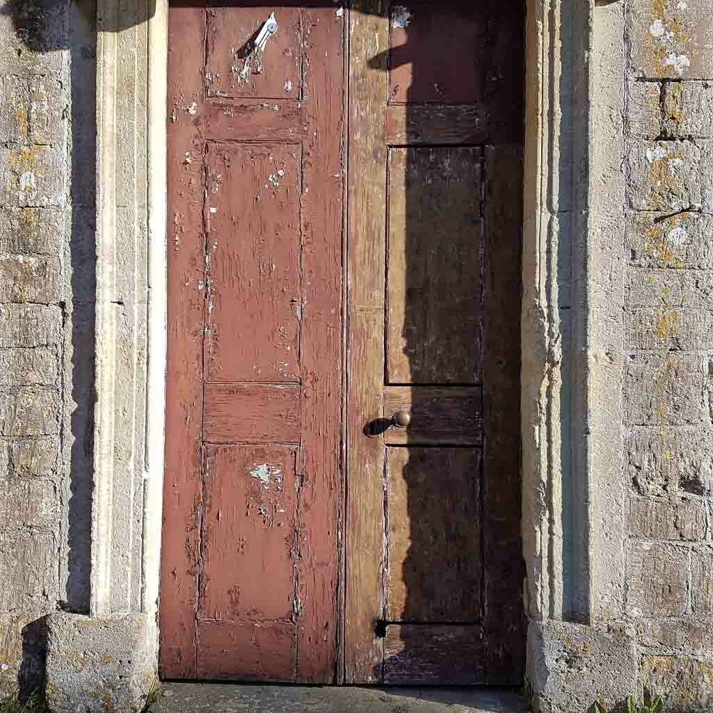 Chapel door with one side part stripped and a burn hole in the lower rail