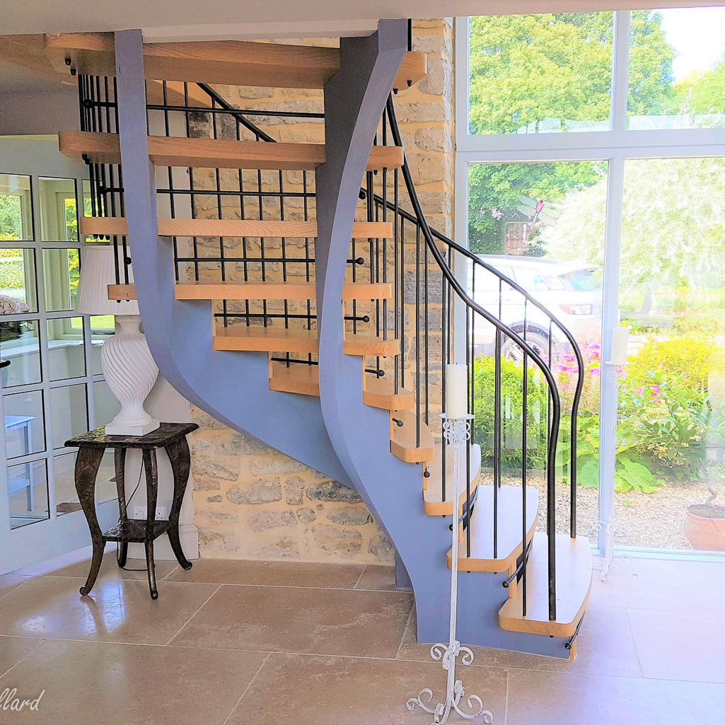 helical staircase with wrought iron handrails under side view