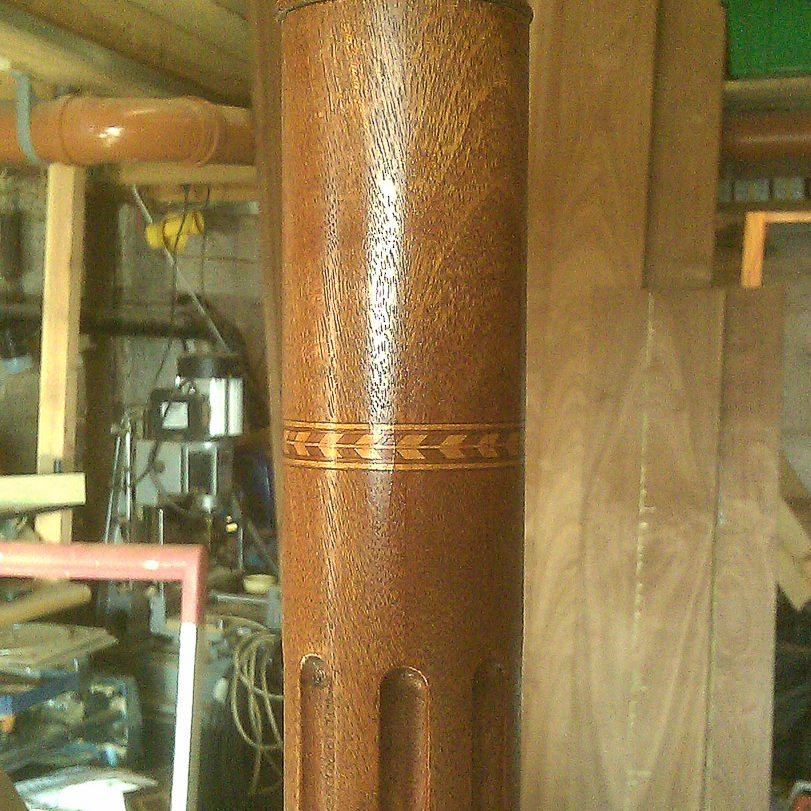 fluted turned post with feather inlay